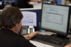 Star Van Systems Employee on the computer